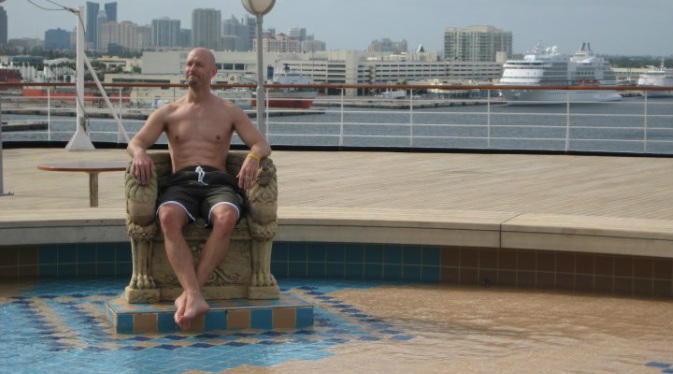 John Roberts, In The Loop Travel, sitting on the pool deck of cruise ship in Miami, Florida