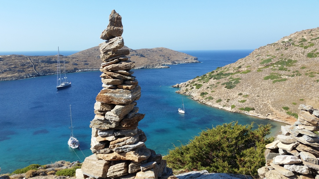 Rock tower and bay at Kythnos, Greece