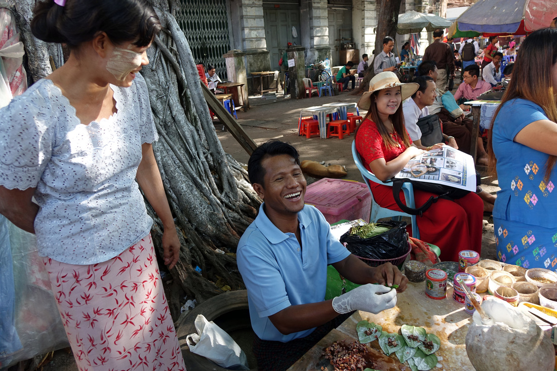 A vendor prepares betel leaves to sell at his open-air stand in Yangon, Burma (Myanmar)
