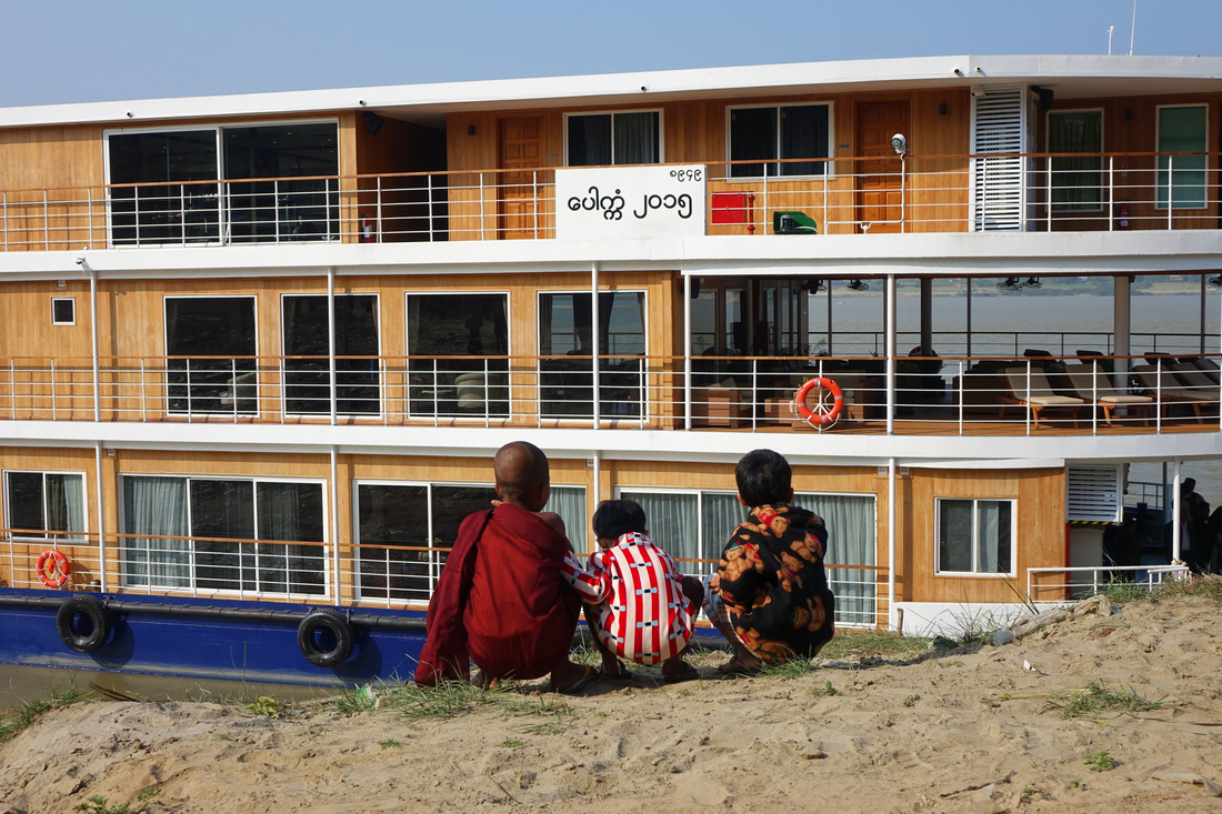 Burmese children look at Avalon Waterways' Avalon Myanmar river ship on the Irrawaddy River