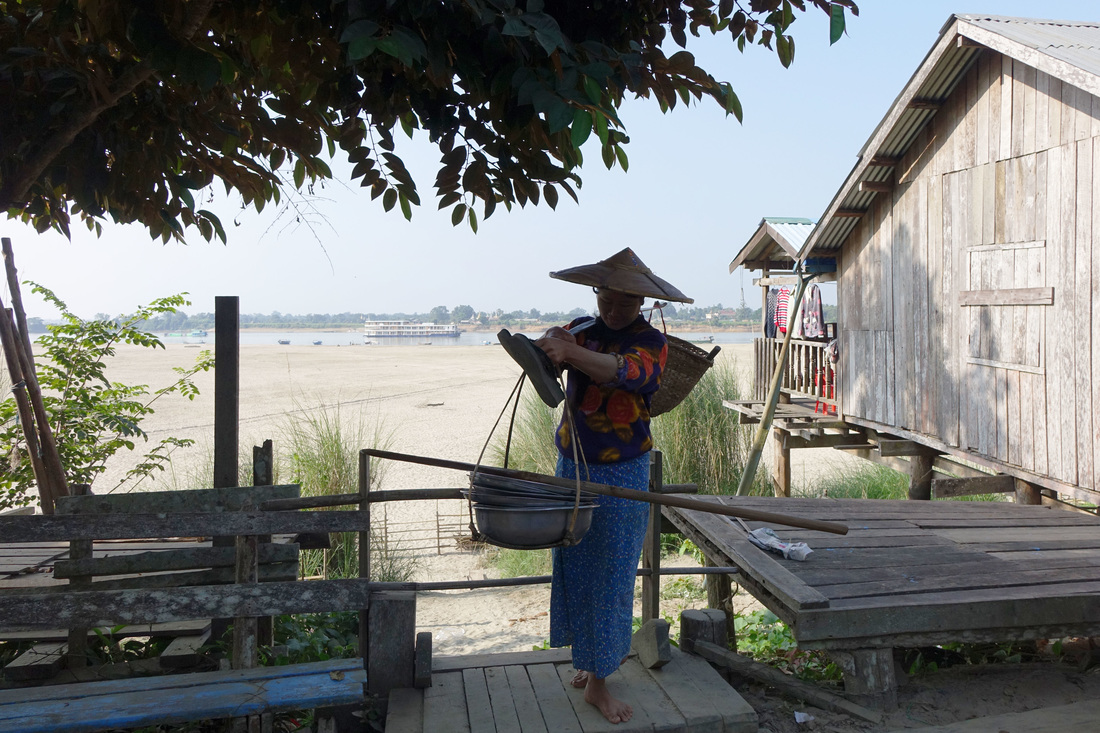 A fishmonger's wife on the island on Kyundaw in Burma