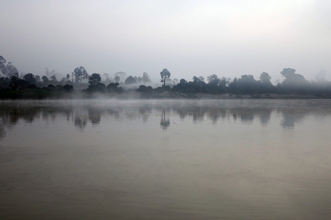 Morning mist rises on the Irrawaddy River in Burma (Myanmar)