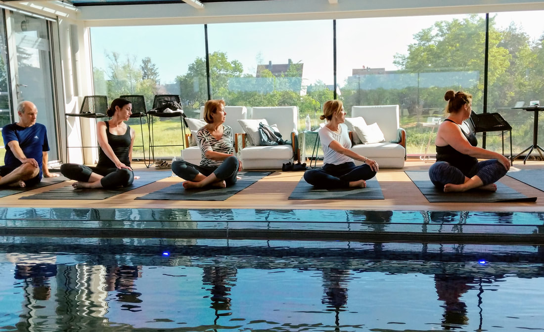 Yoga poolside on Emerald Waterways