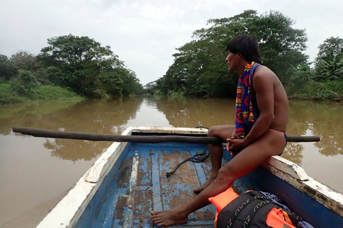 Embera Quera villager in Panama operates his dugout wooden boat