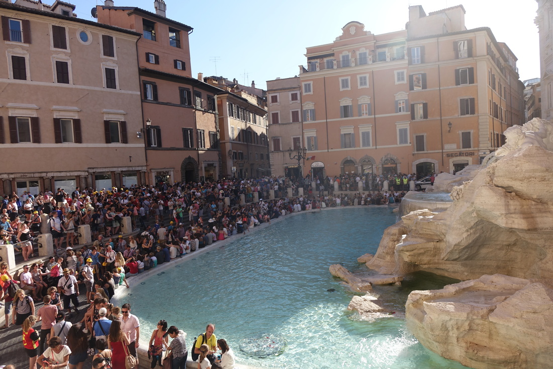Crowded Trevi Fountain in summer in Rome